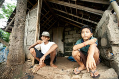 Lembongan - JANUARY 5: old man and boy, collectors of seaweed in Stock Image