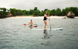 LEMBONGAN - JANUARY 5 :  people row on the surfboards on JANUARY Royalty Free Stock Photography
