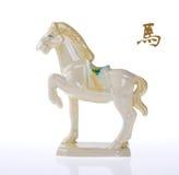 Lembrança cerâmica do cavalo no papel velho Imagens de Stock Royalty Free
