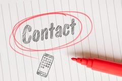 Lembrete do contato em um círculo marcado vermelho imagens de stock royalty free