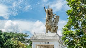 Statue of Lembuswana  in Pulau Kumala, Mythology animal from Indonesia, with blue sky as the background. Lembuswana statue, mythology animal who has head of lion Royalty Free Stock Photos