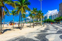 Leme beach and Copacabana beach with palms and mosaic of sidewalk in Rio de Janeiro. View of Leme beach and Copacabana beach with palms and mosaic of sidewalk in stock photo