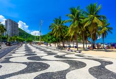 Leme beach and Copacabana beach with palms and mosaic of sidewalk in Rio de Janeiro. View of Leme beach and Copacabana beach with palms and mosaic of sidewalk in stock image