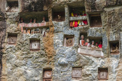 Lemo Tana Toraja, South Sulawesi, Indonesia, famous burial site with coffins placed in caves carved into the rock, guarded by ba. Lconies of dressed wooden stock photo