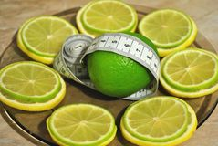 Lemon and лайм help to dump excess weight Stock Photo