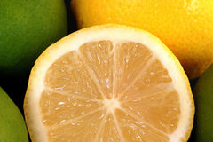 Lemon 02. Cut lemon and lemon and limes on background Royalty Free Stock Photos