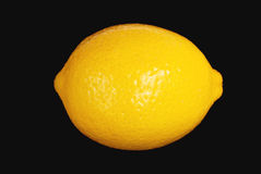 Lemon 04. Yellow lemon on black background Stock Photography
