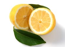 Lemon. Two halves lemon with green leaves Stock Photo