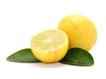 Lemon. Piece of lemon slice with leaves on white Royalty Free Stock Photo