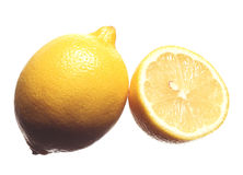 Lemon. Fresh whole lemon and slice Royalty Free Stock Photos