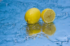 Lemon. On the mirror, usable food, bright and saturated colors, vitamins Royalty Free Stock Photos
