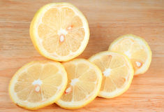 Lemon. Sliced on a chopping board Royalty Free Stock Photography