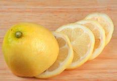 Lemon. Sliced on a chopping board Royalty Free Stock Photo