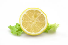 Lemon. A cut lemon on a white background Stock Images