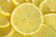 Lemon. Cut by slices,background,close-up Royalty Free Stock Photos
