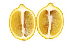Lemon. Cut into half isolated on white Royalty Free Stock Photography