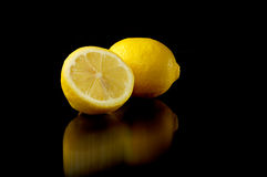 Lemon. Half lemon on black background royalty free stock photo
