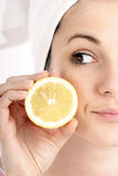 Lemon. Stock Photography of young woman with slice of lemon, close up stock images