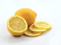 Lemon. One full lemon, one half lemon and three slices lemon stock images
