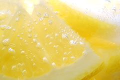Lemon. Slices covered in air bubbles from the sparkling water Royalty Free Stock Photos