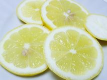 Lemon. Slices of yellow lemon on a white background royalty free stock photo