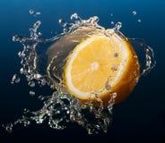 Lemon. In water splash on blue background Royalty Free Stock Photos
