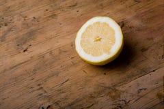 Lemon. Shot of a cut lemon on a vintage kitchen table Royalty Free Stock Photo