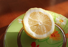 Lemon. Colorful plate with fresh lemon Stock Photos