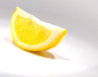 Lemon. Isolated lemon on white gray background royalty free stock photos