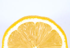 Lemon. Slice on white, space for messages royalty free stock photography
