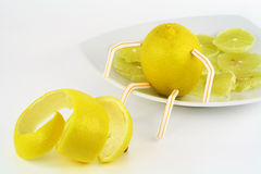 Lemon And Lemon Slices On A Plateau Stock Photos