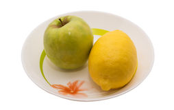 Lemon and apple. Beautiful fresh fruit. The unique combination of taste. The health benefits. The wealth of vitamins Royalty Free Stock Photo