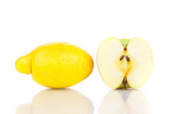 Lemon and apple half close up. Stock Images