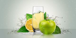 Lemon and Apple juice in a glass with fruit. Stock Images