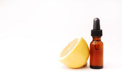 Lemon Aromatherapy. Lemon next to a bottle of essential oil Royalty Free Stock Photos