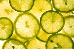 Lemon background. Slices of lemon and lime royalty free stock photography