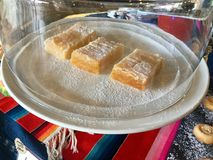 Lemon Bars on Cake. Dessert bars, or simply bars or squares, are a type of American & x22;bar cookie& x22; that has the texture of a firm cake or softer than stock photo