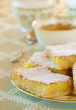 Lemon Bars in an Elegant Table Setting with Tea Stock Images