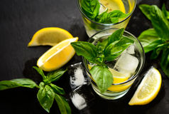 Lemon and basil drink. Alcohol or non alcohol lemon and basil drink, infused water or jin cocktail stock photography