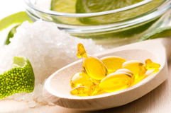 Lemon bath - bath salt, capsule and fresh fruits Stock Photo