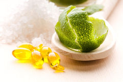 Lemon bath - bath salt, capsule and fresh fruits Stock Image