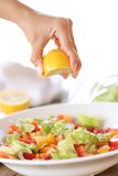 Lemon being added into salad Royalty Free Stock Images