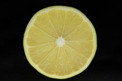 Lemon on black Stock Image