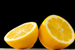 Lemon on black backgound stock images