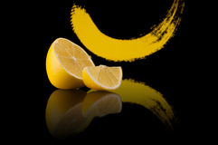 Lemon on a black background with abstract yellow smear and reflection Royalty Free Stock Photography