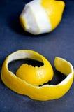 Lemon on a black background. Peeled lemon Stock Images
