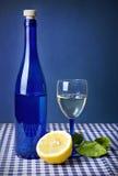 Lemon and blue bottle Royalty Free Stock Photos