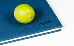 Lemon on blue diary. Of year 2016 Royalty Free Stock Photos