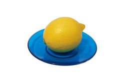 Lemon on a blue saucer. Royalty Free Stock Photos