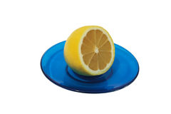 Lemon on a blue saucer. Stock Images